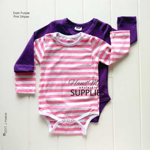 Dark Purple Long Sleeve Bodysuit - Pictured with Pink Stripe Long Sleeve Bodysuit - 180 - 220GSM Weight – lightweight - 95% Cotton 5% Elastane - Self fabric bias binding - Double needle stitching - 3 Crotch Snap Studs - Low Fire Danger Warning Label