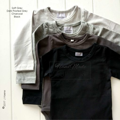Charcoal Long Sleeve Bodysuit - Pictured with Soft Grey and Black Long Sleeve Bodysuits - 180 - 220GSM Weight – lightweight - 95% Cotton 5% Elastane - Self fabric bias binding - Double needle stitching - 3 Crotch Snap Studs - Low Fire Danger Warning Label