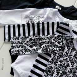 Black Damask Long Sleeve Bodysuit -Pictured with Black Stripe, White and Black Long Sleeve Bodysuits - 180 - 220GSM Weight – lightweight - 95% Cotton 5% Elastane - Self fabric bias binding - Double needle stitching - 3 Crotch Snap Studs - Low Fire Danger Warning Label