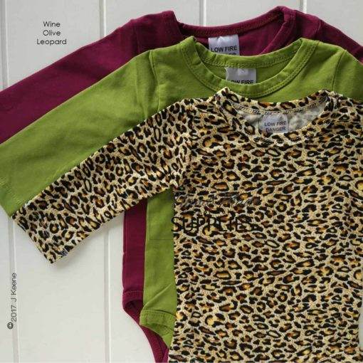 Leopard Print Long Sleeve Bodysuit - Pictured with Ovlie and Wine Long Sleeve Bodysuits - 180 - 220GSM Weight – lightweight - 95% Cotton 5% Elastane - Self fabric bias binding - Double needle stitching - 3 Crotch Snap Studs - Low Fire Danger Warning Label