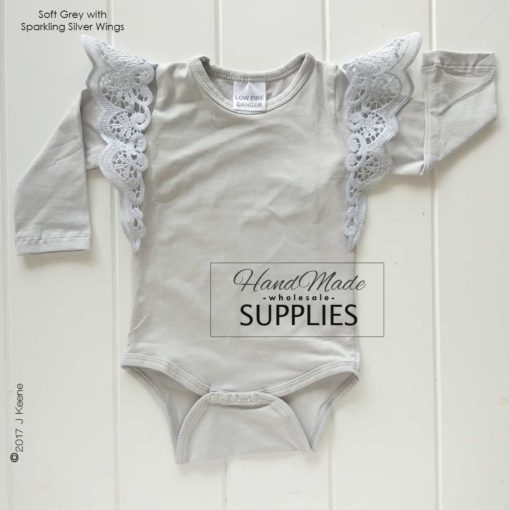 Soft Grey Long Sleeve Bodysuit - 180 - 220GSM Weight – lightweight - 95% Cotton 5% Elastane - Self fabric bias binding - Double needle stitching - 3 Crotch Snap Studs - Low Fire Danger Warning Label **Pixie Wings Not Included**