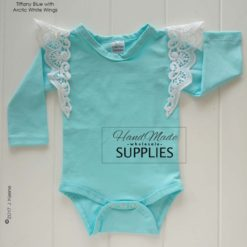 Tiffany Blue Long Sleeve Bodysuit - Pictured with White Pixie Wings - 180 - 220GSM Weight – lightweight - 95% Cotton 5% Elastane - Self fabric bias binding - Double needle stitching - 3 Crotch Snap Studs - Low Fire Danger Warning Label ** Pixie Wings Not Included **