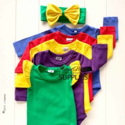 Red Long Sleeve Bodysuit - Pictured with Dorothy (Forest Green & Wiggle Yellow) Flutter Sleeve Bodysuit and Purple, Wiggle Yellow, Royal Blue Long Sleeve Bodysuits. Wiggle and Forest Green Bow. 180 - 220GSM Weight – lightweight - 95% Cotton 5% Elastane - Self fabric bias binding - Double needle stitching - 3 Crotch Snap Studs - Low Fire Danger Warning Label - Wiggle Colours Style Idea ** Other colours and bow not included **